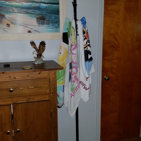 Hang wet towels on a coat rack